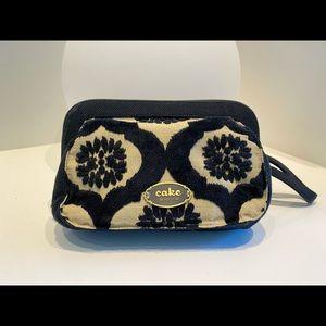 Black and Cream Cake Petunia baby bag wristlet